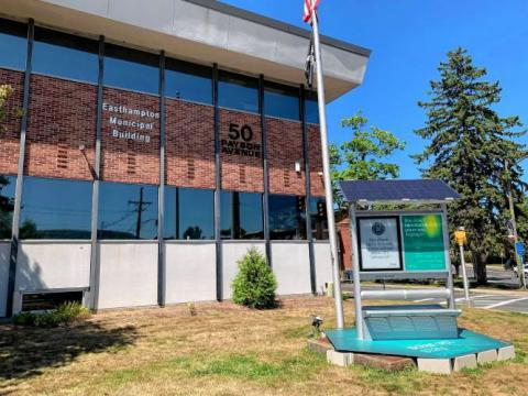 The Solstreet solar-powered bench outside the Easthampton Municipal Building has room for municipal announcements. STAFF PHOTO/MICHAEL CONNORS